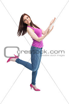 Cheerful stylish brunette wearing high shoes posing
