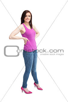 Happy stylish brunette wearing high shoes posing