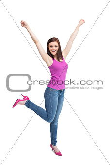 Happy stylish brunette wearing high shoes cheering up
