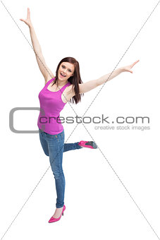 Smiling stylish brunette wearing high shoes cheering up