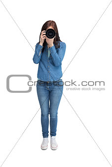 Pretty young photographer taking picture