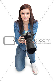 Cheerful young photographer posing