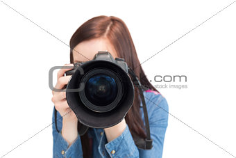 Cute young photographer taking picture of camera