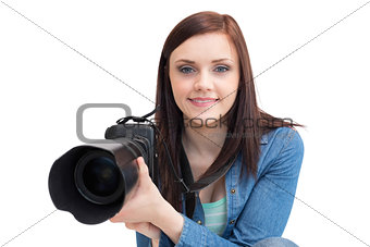 Casual young photographer posing