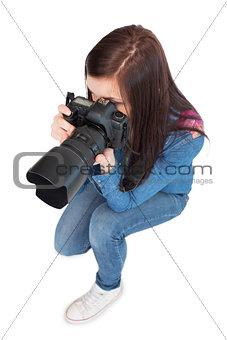 High angle view of casual young photographer taking picture