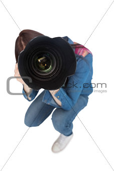 High angle view of young photographer taking picture of camera