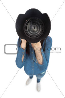 High angle view of casual photographer taking picture of camera