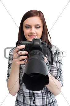 Smiling young casual photographer posing