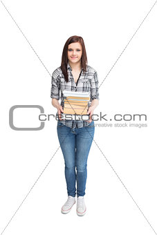 Smiling pretty student holding books