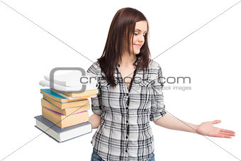 Cheerful pretty student holding pile of books