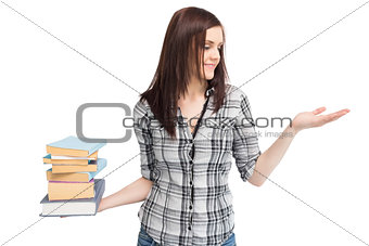 Happy pretty student holding pile of books