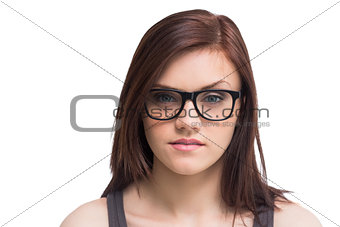 Serious young woman wearing glasses posing