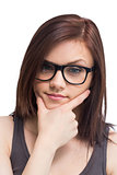 Thinking young woman wearing glasses posing