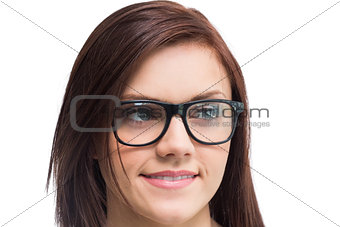 Cheerful young woman wearing glasses posing