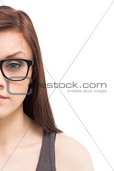 Half face of young woman wearing glasses posing