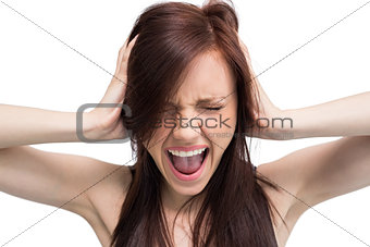Close up on exasperated brunette screaming