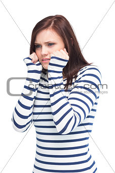 Apprehensive young brunette posing