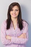 Smiling classy brunette posing