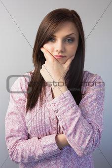 Pensive classy brunette posing