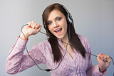 Cheerful young brunette listening to music