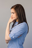 Thoughtful pretty brunette posing