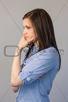 Thoughtful pretty brunette posing