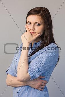 Pensive pretty brunette posing