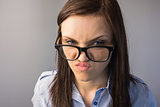Serious brunette with glasses making faces