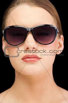 Classy blonde model wearing sunglasses