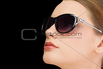 Thoughtful classy blonde wearing sunglasses