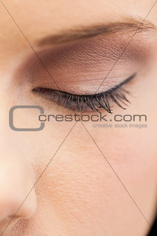Close up on eye wearing eye liner and eye shadow