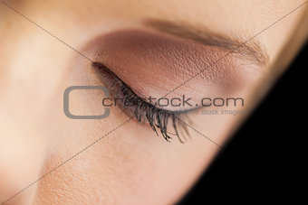 Close up on eye wearing eye liner and natural eye shadow