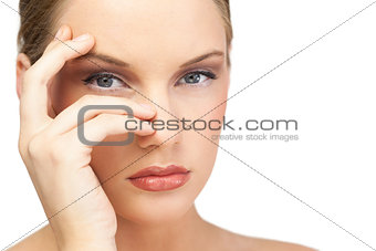 Glamorous model posing hand on face