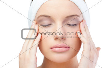 Content blonde model wearing headband closing eyes