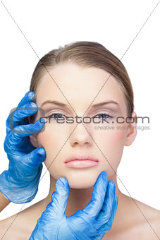 Surgeon examining sexy blonde model