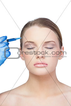Relaxed young model having botox injection