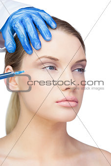 Calm young model having botox injection