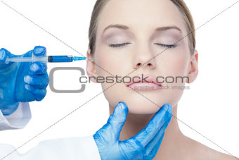 Attractive young model having botox injection on the cheek