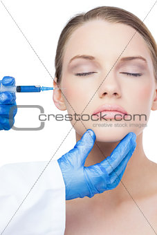 Attractive model having botox injection on the cheek