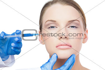 Content attractive model having botox injection on the cheek