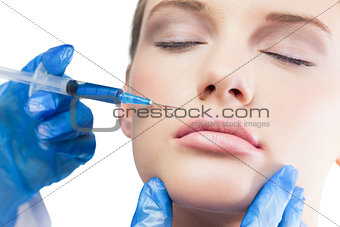 Calm pretty model having botox injection above the lips