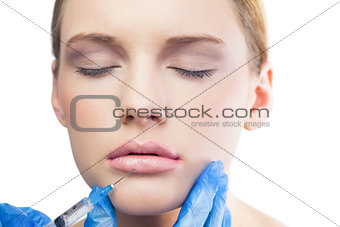 Peaceful pretty model having botox injection on the lips