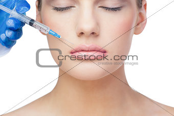 Relaxed beautiful blonde having injection above the lips