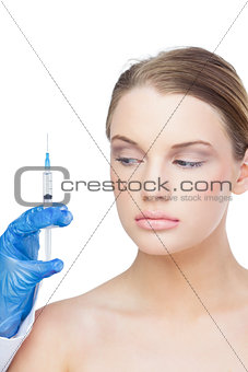 Calm beautiful blonde holding surgical needle