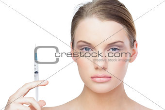 Relaxed pretty model holding surgical needle