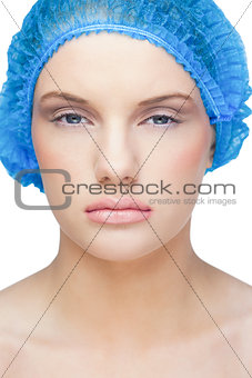 Calm pretty model wearing blue surgical cap