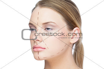 Pretty blonde woman with dotted lines on the face