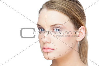 Relaxed pretty blonde with dotted lines on the face