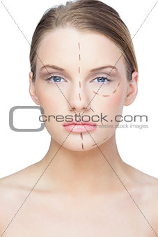 Calm pretty blonde with dotted lines on the face