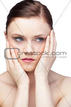 Unsmiling gorgeous brunette posing